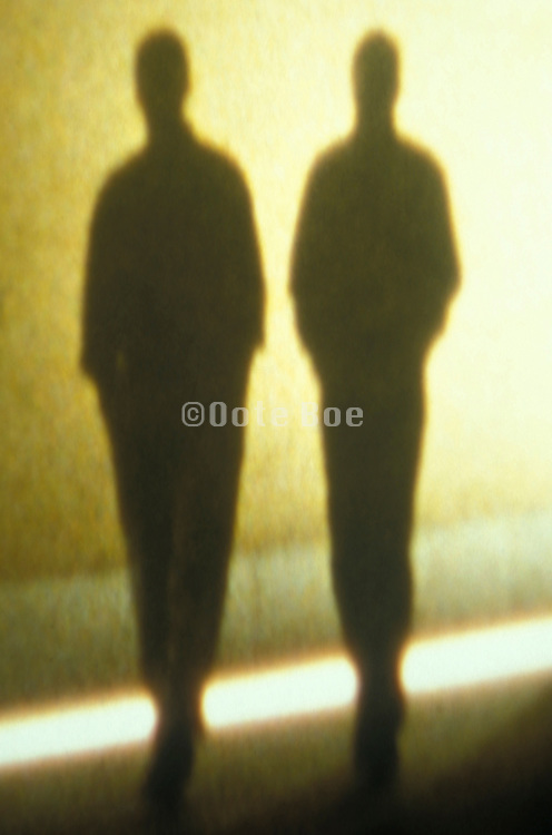 silhouettes of two walking figures