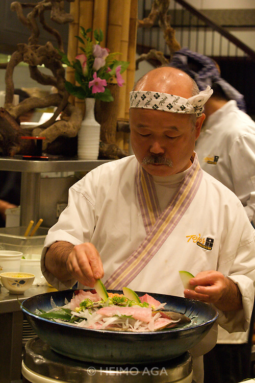 Tojo's Restaurant, possibly the best Japanese restaurant on this side of the Pacific. Legendary founder/owner/chef Hidekazu Tojo, preparing unforgettable Omakase (chef's recommendation) dishes for guests sitting at the sushi bar.