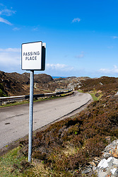 Single track road and passing place on the North Coast 500 scenic driving route in Assynt northern Scotland, UK