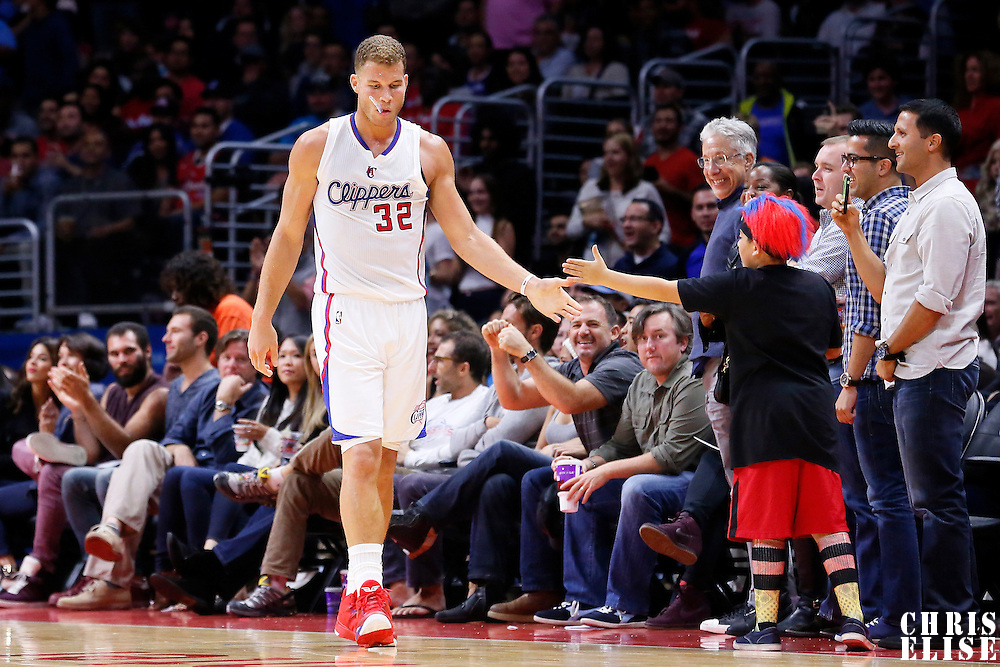17 October 2014: Los Angeles Clippers forward Blake Griffin (32) is seen with a court side fan during the Los Angeles Clippers 101-97 victory over the Utah Jazz, in a preseason game, at the Staples Center, Los Angeles, California, USA.