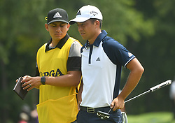 August 12, 2018 - St. Louis, Missouri, U.S. - ST. LOUIS, MO - AUGUST 12: Xander Schauffele is shown with his caddie during the final round of the PGA Championship on August 12, 2018, at Bellerive Country Club, St. Louis, MO.  (Photo by Keith Gillett/Icon Sportswire) (Credit Image: © Keith Gillett/Icon SMI via ZUMA Press)