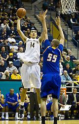 December 29, 2009; Berkeley, CA, USA;  California Golden Bears center Max Zhang (14) shoots over UC Santa Barbara Gauchos center Greg Somogyi (55) during the first half at Haas Pavilion.  California defeated UC Santa Barbara 87-66.