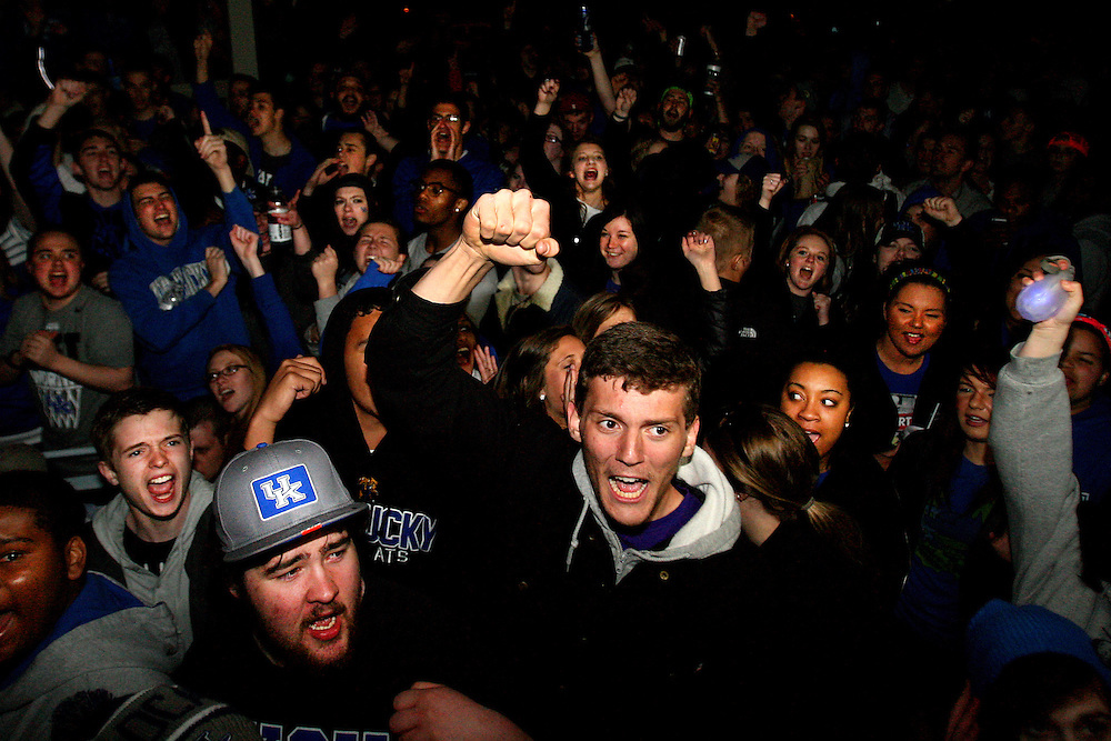 Fans react to a three pointer in the second half during UK's National Championship run while watching the game on State Street. The magical run ended in the National Championship as Kentucky lost to UConn and was left with only a runner-up title after starting as a 8-seed.