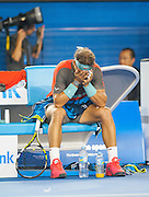 Rafael Nadal shows pain and frustration during a break in match action.Stanislaus Wawrinka of Switzerland defeated the number one player in the world R. Nadal of Spain to claim the 2014 Australian Open Men's Singles Championship. The Swiss won 6-3 6-2 3-6 6-3 in a match that will be remembered for a confusing and sometimes bizarre final three sets, with Nadal clearly hampered by a left lower back injury and seemingly on the verge of retirement in the second set.. The match was held on center court at Melbourne's Rod Laver Arena.