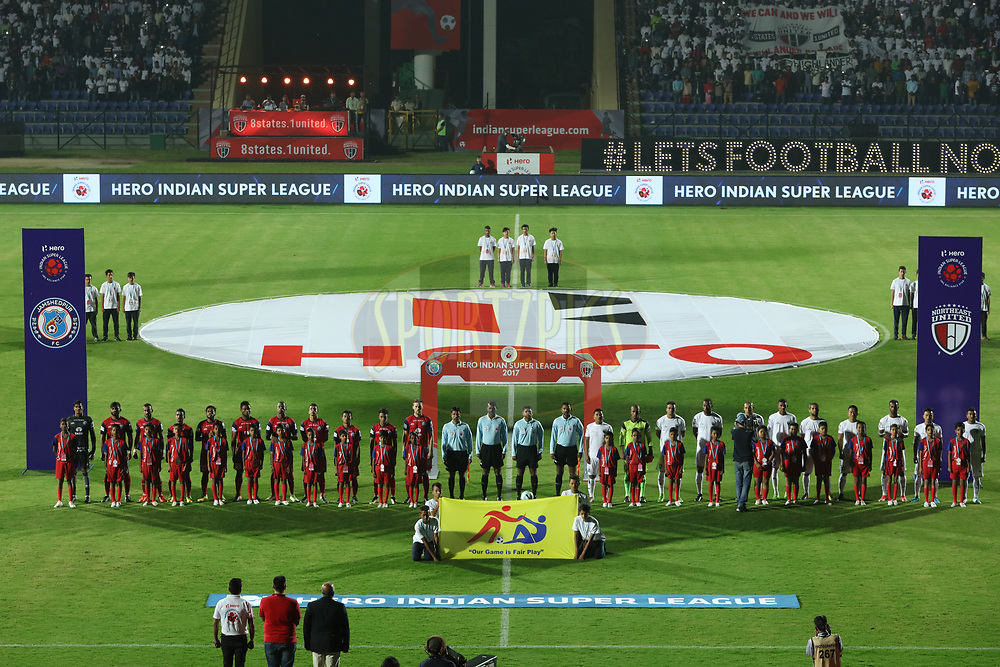 Players and officials at National anthem during match 2 of the Hero Indian Super League between NorthEast United FC and Jamshedpur FC held at the Indira Gandhi Athletic Stadium, Guwahati India on the 18th November 2017<br /> <br /> Photo by: Saikat Das  / ISL / SPORTZPICS