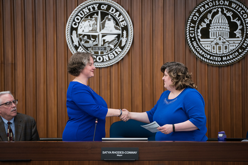 Madison Mayor Satya Rhodes-Conway is sworn in by City Clerk Maribeth Witzel-Behl at the City County Building in Madison, WI on Tuesday, April 16, 2019.