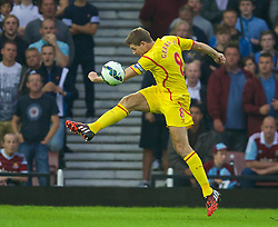 LONDON, ENGLAND - Saturday, September 20, 2014: Liverpool's captain Steven Gerrard in action against West Ham United during the Premier League match at Upton Park. (Pic by David Rawcliffe/Propaganda)
