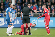 Controversy as C. Boyeson (Referee) tells the Carlisle United player to go to the sideline to receive treatment. After a long exchange, the referee allows the physio to come onto the pitch during the EFL Sky Bet League 2 match between Hartlepool United and Carlisle United at Victoria Park, Hartlepool, England on 14 April 2017. Photo by Mark P Doherty.