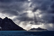 Passing thre the  Drygalski Fjord beams of light broke through the clouds.