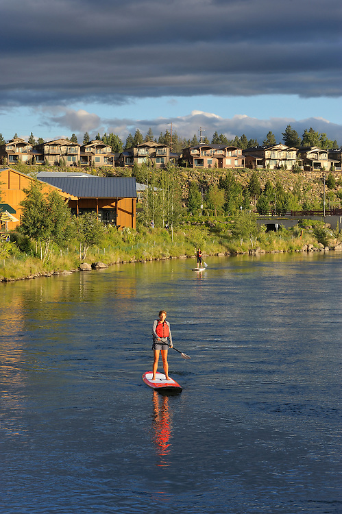 Paddle boarding,Deschutes river,Old Mill district,Bend,Central Oregon,USA