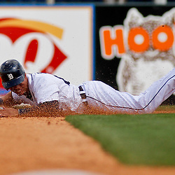 March 14, 2012; Lakeland, FL, USA; Detroit Tigers center fielder Quintin Berry (66) steals second base past New York Mets second baseman Jordany Valdespin (61) during the bottom of the fifth inning of a spring training game at Joker Marchant Stadium. Mandatory Credit: Derick E. Hingle-US PRESSWIRE