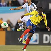 Enner Valencia, (right) Ecuador, is challenged by Javier Mascherano, Argentina, during the Argentina Vs Ecuador International friendly football match at MetLife Stadium, New Jersey. USA. 15th November 2013. Photo Tim Clayton