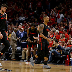 Apr 19, 2018; New Orleans, LA, USA; Portland Trail Blazers guard Damian Lillard (0) and center Jusuf Nurkic (27) walk to the bench during the second half in game three of the first round of the 2018 NBA Playoffs against the New Orleans Pelicans at the Smoothie King Center. The Pelicans defeated the Trail Blazers 119-102.  Mandatory Credit: Derick E. Hingle-USA TODAY Sports