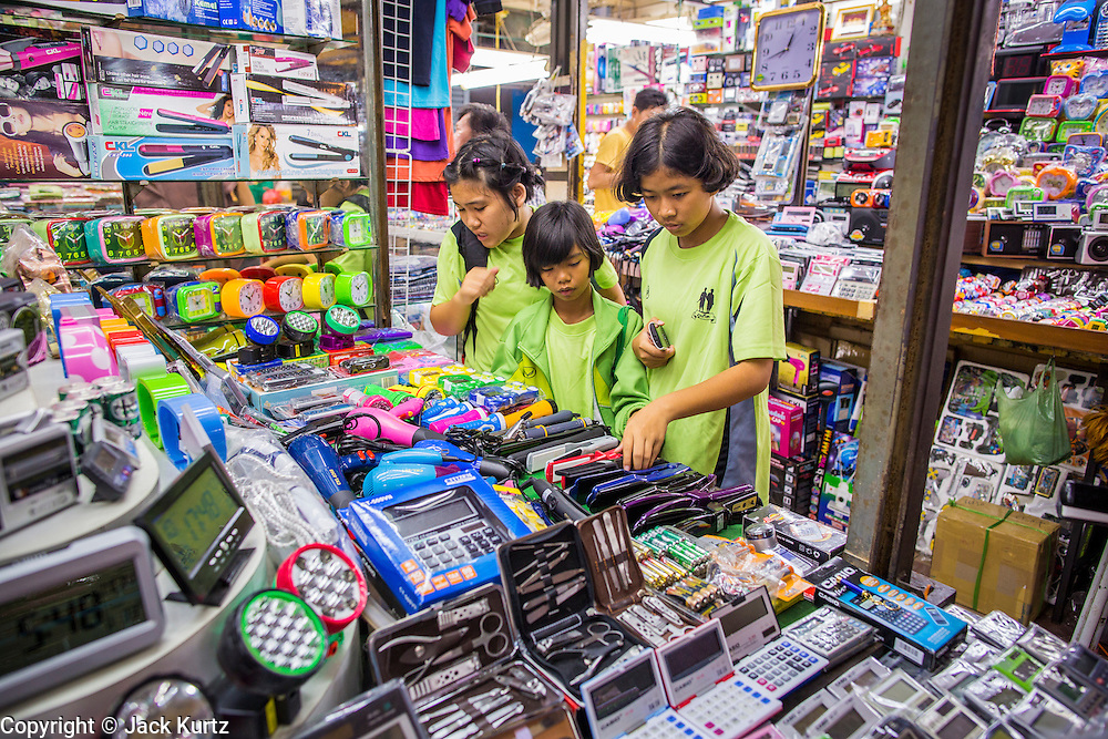 22 OCTOBER 2012 - HAT YAI, THAILAND:      Thai children in their uniforms shop in the market in Hat Yai, Thailand. Hat Yai is the largest in southern Thailand. It is an important commercial center and tourist destination. It is especially popular with Malaysian, Singaporean and Chinese tourists.     PHOTO BY JACK KURTZ