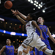 Moriah Jefferson, UConn, drives to the basket past Megan Podkowa, DePaul, during the UConn Vs DePaul, NCAA Women's College basketball game at Webster Bank Arena, Bridgeport, Connecticut, USA. 19th December 2014