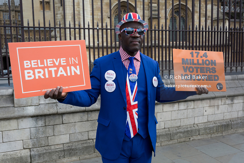 As MPs decide on how to progress with Brexit parliamentary procedure, a Leaver Brexiteer protests in front of railings outside the UK Parliament in Westminster, on 28th March 2019, in London, England