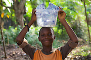 A boy carrying sachets of water to sell on the street.<br /> <br /> Idorenyin Samual runs 'Doren Water', which produces sachets of purified drinking water.<br /> <br /> Idorenyn (Doren) recently attended the business training workshop run by Youth for Technology and also signed up to the business support text message service.<br /> <br /> She found them useful to learn about customer management and bookkeeping.