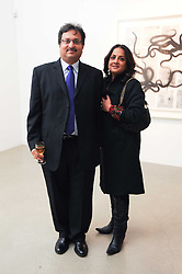 The HON.AKASH & MRS PAUL at a party to celebrate the publication of Allegra Hick's book 'An Eye For Design' held at he Timothy Taylor Gallery, Carlos Place, London on 23rd November 2010.
