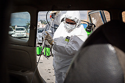 JOHANNESBURG, April 16, 2020  A staff member disinfects a car in Johannesburg, South Africa, April 16, 2020. South Africa on Wednesday reported seven more deaths from the novel coronavirus, bringing the death toll to 34. The total number of confirmed cases in the country surged to 2,506, up by 91 from Tuesday's announcement. (Photo by Yeshiel/Xinhua) (Credit Image: © Xinhua via ZUMA Wire)