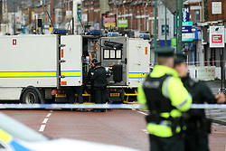 © Licensed to London News Pictures. 4/03/2016. Belfast, Northern Ireland, UK. PSNI (Police Service of Northern Ireland) Police officers stand beside British Army Bomb disposal teams, close to the scene of an early morning van bomb explosion in east Belfast.A 52 year old man, who is a serving prison officer, has since died it has been announced today. Photo credit : Paul McErlane/LNP