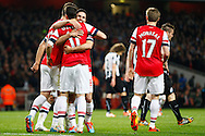 Mesut Ozil of Arsenal (11) celebrates scoring his team's second goal with team mates during the Barclays Premier League match at the Emirates Stadium, London<br /> Picture by David Horn/Focus Images Ltd +44 7545 970036<br /> 28/04/2014