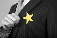 Businessmen with Golden Star on Suit