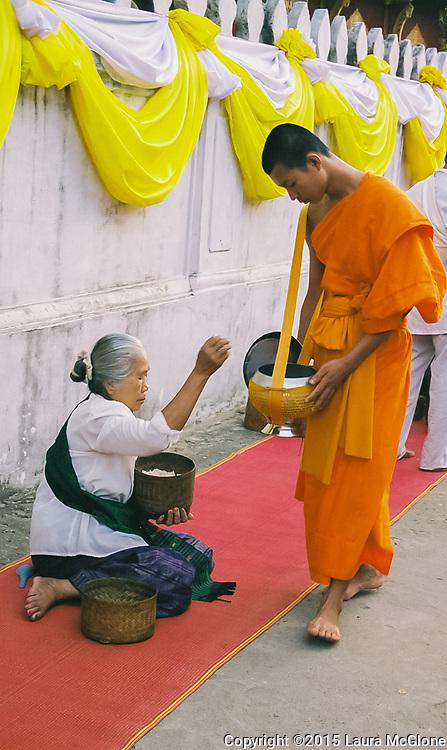 Monk receiving alms, Luang Prabang, Laos