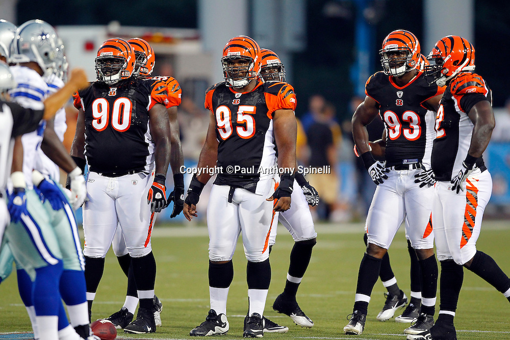 Cincinnati Bengals defensive tackle Orien Harris (95), linebacker Michael Johnson (93), and defensive tackle Pat Simms (90) wait for the offense during the NFL Pro Football Hall of Fame preseason football game between the Dallas Cowboys and the Cincinnati Bengals on Sunday, August 8, 2010 in Canton, Ohio. The Cowboys won the game 16-7. (©Paul Anthony Spinelli)