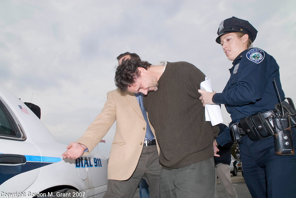 East Hampton, NY - 3/14/07 -   Dr. Michael Chait is escorted out of East Hampton Town Justice Court by East Hampton Town Police in East Hampton, NY March 14, 2007 after being arraigned on charges of writing fake prescriptions. The raid on the doctors office Tuesday morning came after a 3 month investigation by the State Attorneys General Office. County, State and East Hampton Town Police, as well as the DEA participated in the raid that took place Tuesday morning.    (Photo by Gordon M. Grant)
