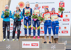 24.02.2019, Langlauf Arena, Seefeld, AUT, FIS Weltmeisterschaften Ski Nordisch, Seefeld 2019, Langlauf, Damen, Teambewerb, Flower Zeremonie, im Bild v.l. Silbermedaillengewinnerin Katja Visnar, Anamarija Lampic (SLO), Weltmeisterin und Goldmedaillengewinnerin Stina Nilsson, Maja Dahlqvist (SWE), Bronzemedaillengewinnerin Ingvild Flugstad Oestberg, Maiken Caspersen Falla (NOR) // f.l. Silver medalist Katja Visnar Anamarija Lampic of Slovenia World champion and Gold medalist Stina Nilsson Maja Dahlqvist of Sweden and Bronce medalist Ingvild Flugstad Oestberg Maiken Caspersen Falla of Norway during the flowers ceremony for the ladie's cross country team competition of FIS Nordic Ski World Championships 2019 at the Langlauf Arena in Seefeld, Austria on 2019/02/24. EXPA Pictures © 2019, PhotoCredit: EXPA/ Stefan Adelsberger