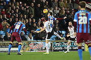 Tommy Rowe of Scunthorpe United and Dean Hammond of Sheffield United both go for the ball in the air  during the Sky Bet League 1 match between Scunthorpe United and Sheffield Utd at Glanford Park, Scunthorpe, England on 19 December 2015. Photo by Ian Lyall.
