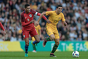 Tomas Rogic (Australia) runs with the ball as Chris Smalling (England) tries to keep up during the Friendly International match match between England and Australia at the Stadium Of Light, Sunderland, England on 27 May 2016. Photo by Mark P Doherty.