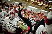 (Cambridge, MA - February 26, 2010) Robert L. Scalise, Harvard's Nichols Family Director of Athletics, presents Katey Stone, the Landry Family Head Coach for Harvard Womenís Ice Hockey, with flowers after the game after she became the winningest coach in Women's NCAA Division I Ice Hockey in history, as the fourth-ranked Crimson womenís hockey team defeated Princeton by a score 5-1 in Game 1 of the ECAC Hockey quarterfinals. Staff Photo Justin Ide/Harvard University News Office