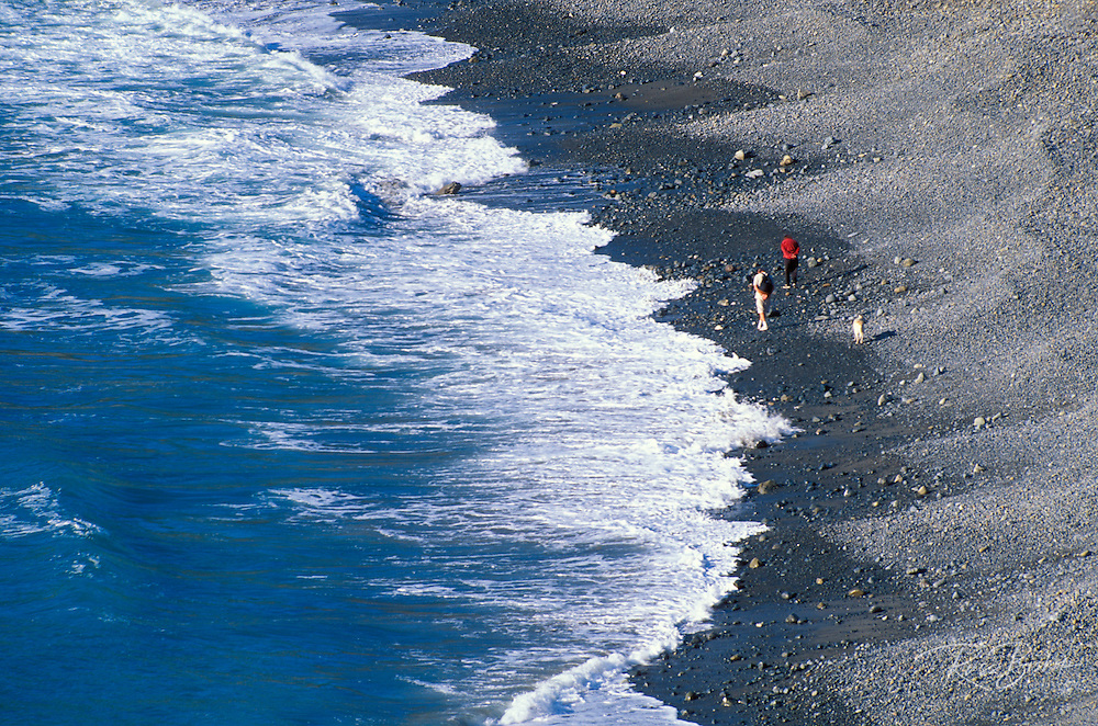 Beachcombers along the surf at Sand Dollar Beach, Los Padres National Forest, Big Sur Coast, California