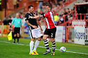 Neal Eardley (23) of Lincoln City is pushed away by Pierce Sweeney (2) of Exeter City after clashing during the EFL Sky Bet League 2 match between Exeter City and Lincoln City at St James' Park, Exeter, England on 19 August 2017. Photo by Graham Hunt.
