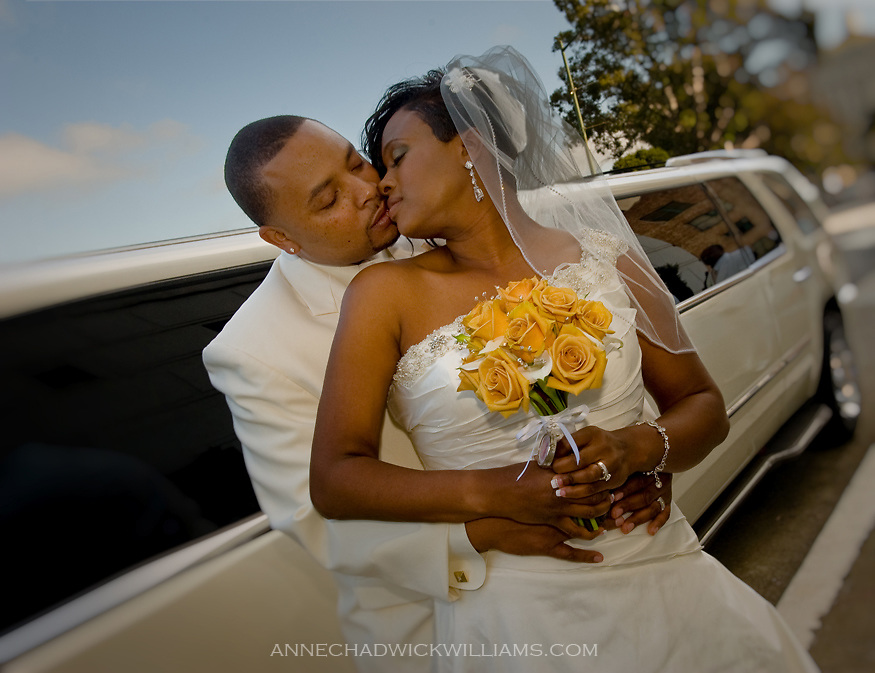 A bride and groom kiss after their wedding at Scottish Rite Temple in Oakland, CA.