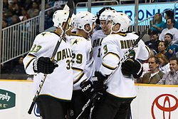 March 5, 2011; San Jose, CA, USA;  Dallas Stars left wing Jamie Benn (back, center) celebrates with defenseman Alex Goligoski (33), center Steve Ott (29) and defenseman Stephane Robidas (3) after scoring a short handed goal against the San Jose Sharks during the first period at HP Pavilion. Mandatory Credit: Jason O. Watson / US PRESSWIRE