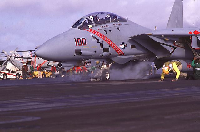 F-14 Tomcat frm VF-102 Diamondbacks based onboard USS-Theodore Roosevlet (CVN-71) prepares to launch from Cat 4