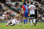Crystal Palace midfielder, Mile Jedinak (15) helping Fulham midfielder, Kevin McDonald onto his feet after a tackle during the Pre-Season Friendly match between Fulham and Crystal Palace at Craven Cottage, London, England on 30 July 2016. Photo by Matthew Redman.
