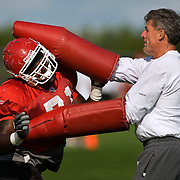 Kansas City Chiefs defensive line coach Tim Krumrie, right, donned padded sleeves in a drill with Chiefs defensive end Alex Magee, left, at the team's training camp on the campus of the University of Wisconsin-River Falls.