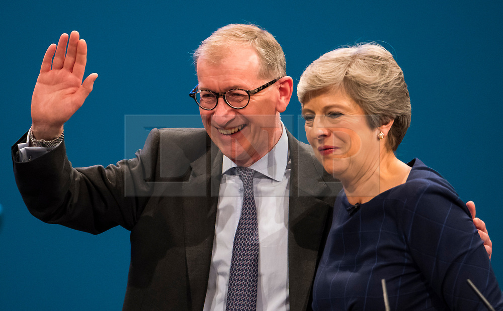 © Licensed to London News Pictures. 04/10/2017. Manchester, UK. British prime minister THERESA MAY and her husband PHILIP leave the stage after she delivered her leaders speech on the final day of the Conservative Party Conference. The four day event is expected to focus heavily on Brexit, with the British prime minister hoping to dampen rumours of a leadership challenge. Photo credit: Ben Cawthra/LNP