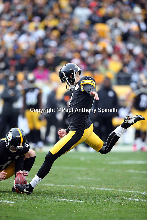 Pittsburgh Steelers punter Jordan Berry (4) holds while Pittsburgh Steelers place kicker Chris Boswell (9) kicks a 28 yard field goal for an 18-13 fourth quarter lead during the 2015 NFL week 6 regular season football game against the Arizona Cardinals on Sunday, Oct. 18, 2015 in Pittsburgh. The Steelers won the game 25-13. (©Paul Anthony Spinelli)