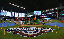 April 10, 2017 - Miami, FL, USA - The Miami Marlins take batting practice before the start of the home opener, against the Atlanta Braves, at Marlins Park in Miami on Tuesday, April 11, 2017. (Credit Image: © David Santiago/TNS via ZUMA Wire)