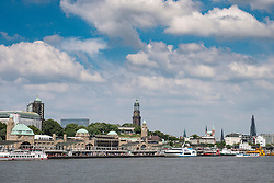 View of boat landing jetties, Landungsbrucken and skyline of city at St Pauli in port of Hamburg Germany