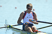Varese,  ITALY. 2012 FISA European Championships, Lake Varese Regatta Course. ..GBR M1X. Graeme THOMAS, at the start of his heat of the Men's Single Sculls..12:36:51  Friday  14/09/2012 .....[Mandatory Credit Peter Spurrier:  Intersport Images]  ..2012 European Rowing Championships Rowing, European,  2012 010777.jpg.....