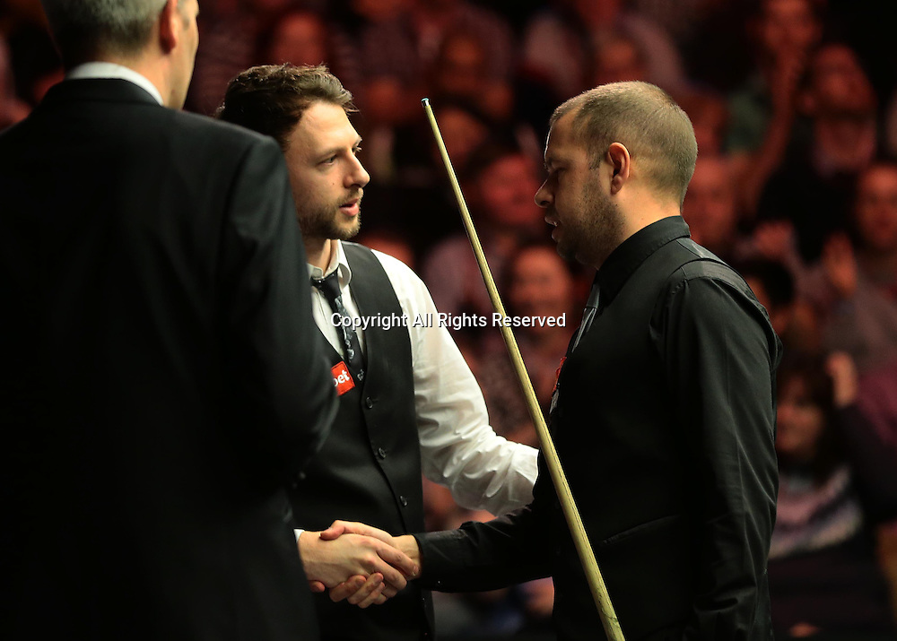 16.01.2016.  Alexandra Palace, London, England. Masters Snooker. Semi Finals. Barry Hawkins is congratulated by Judd Trump as he wins the Semi Final 6 frames to 4