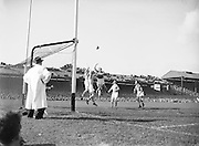 Players jump in an attempt to reach the ball in front of the Kerry goalmouth during the All Ireland Senior Gaelic Football Final Kerry v Dublin in Croke Park on the 25th September 1955. Kerry 00-12 Dublin 01-06.