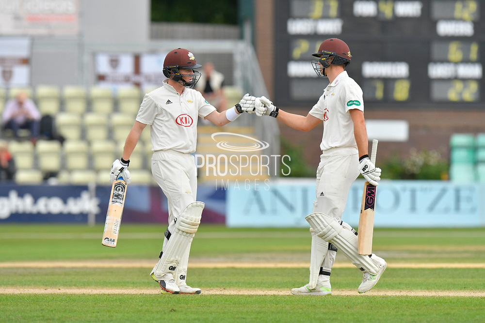Ollie Pope of Surrey and Will Jacks of Surrey touch gloves during the final day of the Specsavers County Champ Div 1 match between Worcestershire County Cricket Club and Surrey County Cricket Club at New Road, Worcester, United Kingdom on 13 September 2018.