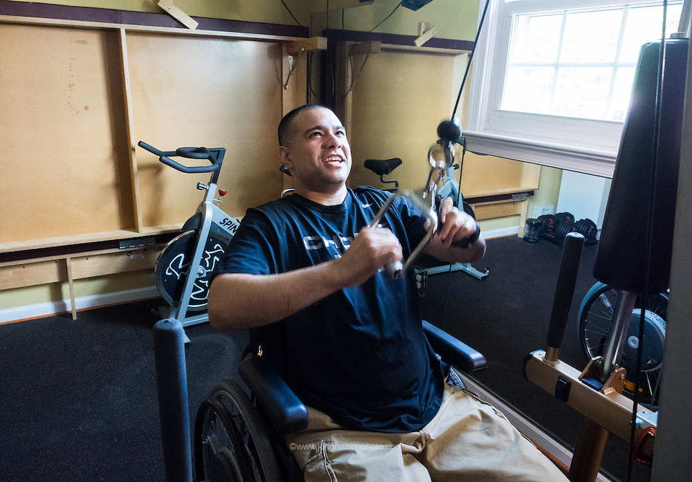 Afganistan war vet Josh Himan works out in a customized gym at his family's home in Woodbridge, VA.