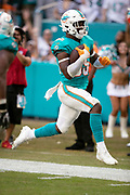 Miami Dolphins rookie outside linebacker Jerome Baker (55) intercepts a fourth quarter pass and returns it 25 yards for a touchdown and a 13-3 Dolphins lead during the NFL week 9 regular season football game against the New York Jets on Sunday, Nov. 4, 2018 in Miami Gardens, Fla. The Dolphins won the game 13-6. (©Paul Anthony Spinelli)